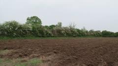 plowed field + pan tractor plowing (on camera)