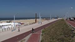 Reinforced Dutch coast. Refurbished Scheveningen Boulevard at North Sea beach, designed in different heights, meant to separate pedestrians, cyclists and cars. SCHEVENINGEN, THE NETHERLANDS - JUNE 2013