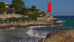 Red flag at the beach of Cala Molins in Cala San Vicente, Majorca, Balearic Islands, Spain, Mediterranean, Europe