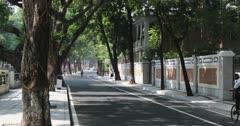 People cycling along road in Dongshan area, Guangzhou, Guangdong, China, Asia