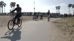Cyclists on Ocean Walk at Venice Beach, Santa Monica, Los Angeles, California, United States of America, North America