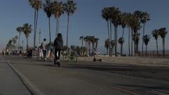 Cyclists on beach path at Venice Beach, Santa Monica, Los Angeles, California, United States of America, North America