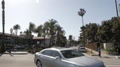 Palm trees and traffic on West Cabrillo Boulevard, Santa Barbara, California, United States of America, North America