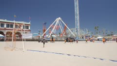 Crane shot of Santa Cruz Broadwalk funfair ride and beach, Santa Cruz, California, United States of America, North America