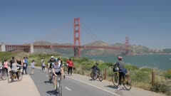 View of cyclists and the Golden Gate Bridge from Golden Gate Welcome Centre, San Francisco, California, United States of America, North America