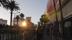 Sunset over people walking on The Strip near Flamingo Hotel and Casino, Las Vegas Boulevard, Las Vegas, Nevada, USA