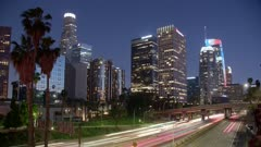 Time-Lapse of Downtown skyline and Harbour Freeway at dusk, Los Angeles, LA, California, United States of America, North America