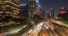 Time lapse of 110 Freeway through Downtown Financial District at night, Los Angeles, California, USA, North America