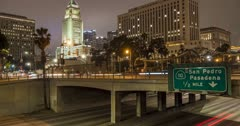 Time lapse of Sant Ana Freeway and City Hall, Downtown Financial District at night, Los Angeles, California, USA, North America