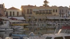 Sunset over Old Venetian harbour, taverns on seaside, Rethymno, Crete, Greek Islands, Greece, Europe
