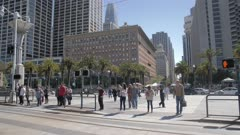 Pedestrians crossing The Embarcadero from Market Street, San Francisco, California, United States of America, North America