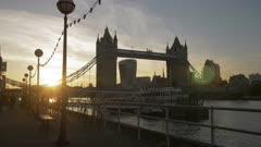 Tracking shot of Sunset at Tower Bridge from Butlers Wharf, Southwark, London, England, United Kingdom, Europe