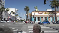 People crossing Hollywood Boulevard, Hollywood, Los Angeles, LA, California, United States of America, North America