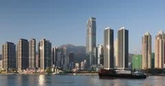 Ship passing Tsuen Wan skyline with Nina Tower, Hong Kong