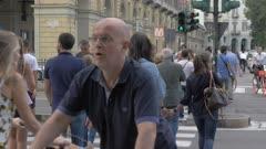 Pedestrians outside Torino Porta Nuova railway station in Turin, Italy, Europe