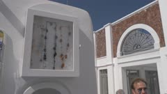 Necklace display by clock tower in Oia, Santorini, Greece, Europe