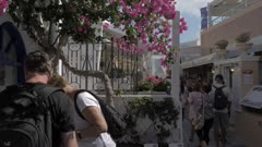 People on footpath in Oia, Santorini, Greece, Europe