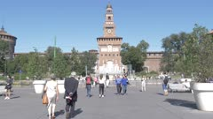Pedestrians by fountain and Sforza Castle in Milan, Italy, Europe