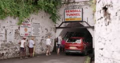 Pedestrians and vehicles going under Sendall Tunnel, St. George'?s, Grenada, West Indies, Caribbean, Central America