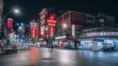Timelapse of bright neon shop and hotel lights by busy main road of Chinatown in Bangkok, Thailand, Southeast Asia, Asia