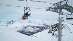 Skiers getting off the ski lift at La Plagne ski resort, Tarentaise, Savoy, French Alps, France, Europe