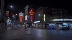 Bright neon shop and hotel lights by busy main road of Chinatown in Bangkok, Thailand, Southeast Asia, Asia
