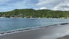 Calm waters lapping on beach, anchored yachts, Port Elizabeth, Bequia, St. Vincent and the Grenadines, West Indies, Caribbean, Central Amrica