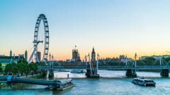 London Eye and Houses of Parliament at dusk from River Thames, time lapse, London, England, United Kingdom, Europe