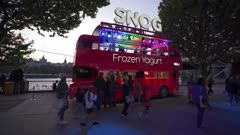 Tracking shot of double decker bus at Riverside at dusk, Southwark, London, England, United Kingdom, Europe