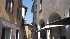 Narrow street and cafe in Cannobio on Lake Maggiore, Lake Maggiore, Piedmont, Italian Lakes, Italy, Europe