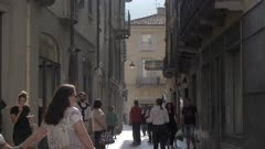 People on busy street near Cathedral of Como, Como, Lake Como, Lombardy, Italian Lakes, Italy, Europe