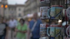 People and souvenir mugs in Piazza del Duomo at dusk, Como, Lake Como, Lombardy, Italian Lakes, Italy, Europe