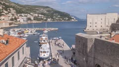 Time lapse of boats leaving and entering Old Town Harbour from elevated position, UNESCO World Heritage Site, Dubrovnik, Dubrovnik Riviera, Croatia, Europe