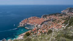 Time lapse of boats leaving and entering Old Town Harbour from elevated position, Old Town, UNESCO World Heritage Site, Dubrovnik, Dubrovnik Riviera, Croatia, Europe