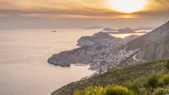 Time lapse of boats leaving and entering Old Town Harbour from elevated position at sunset, Old Town, UNESCO World Heritage Site, Dubrovnik, Dubrovnik Riviera, Croatia, Europe