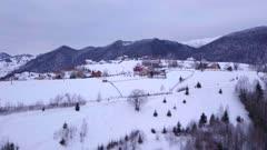 View by drone of snowy winter landscape in the Carpathian Mountains near Bran Castle, Transylvania, Romania, Europe