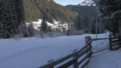 View of cross country skiers near Canazei in background, Province of Trento, Trentino-Alto Adige/Sudtirol, Italy, Europe