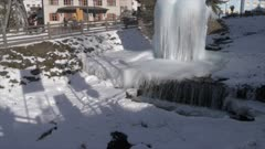 View of ice fountain in town centre of Canazei on sunny day at Christmas, Province of Trento, Trentino-Alto Adige/Sudtirol, Italy, Europe