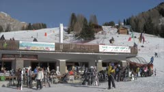 View of skiers and cable cars at Pecol on sunny day in winter, Province of Trento, Trentino-Alto Adige/Sudtirol, Italy, Europe