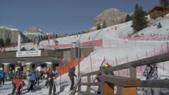 View of skiers at Pecol on sunny day in winter, Province of Trento, Trentino-Alto Adige/Sudtirol, Italy, Europe