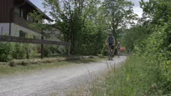 Cyclists, mountains and meadows near Ulrich am Pillersee, Austrian Alps, Tyrol, Austria, Europe