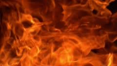 Slow motion fierce furnace burn and release ash.