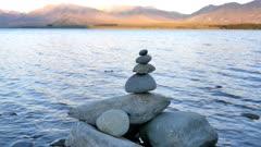 Zen stone with the background of Mount John at Lake Tekapo, South Island, New Zealand.