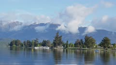 Te Anau lake with snow mountain