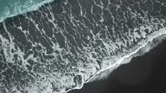 Aerial view the wave hit the sand at beach