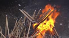Slow motion burning of joss stick at furnace.