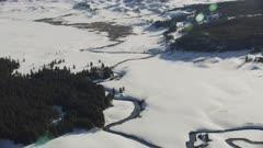8k snowy landscape river winding through Yellowstone