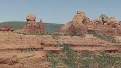 8k wide shot of red rock formations in painted desert