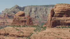 8k wide shot of red rock formations and mountain in painted desert