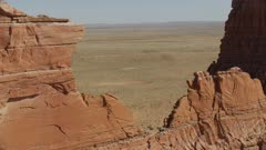8k reveal through rock formations and red Cliffs to painted desert